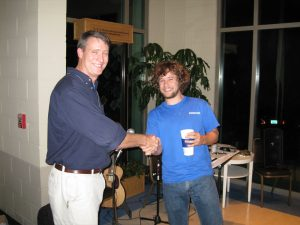 Undergraduate student, Elliot Hart, is awarded the Best Undergraduate Poster award by Don Behringer.